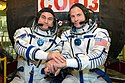 Soyuz MS-10 crew members in front of their spacecraft.jpg