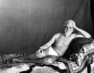 Sri Ramana Ashram - Sri Ramana Maharshi reclining in the Old Hall where he lived from 1927 to 1950