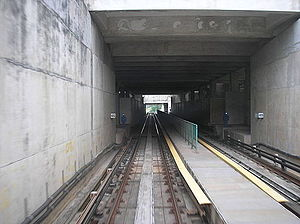 Sri Rampai LRT station - Sri Rampai station as viewed on a northbound train in March 2007, revealing the location in a mothballed state with boarded-up side platforms and an unfinished interior.