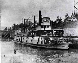Cascade Locks, Oregon - Sternwheeler J.N. Teal in Cascade Locks, 1911. Note Brass Era cars on foredeck.