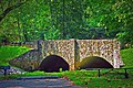 Stone arch bridge over Paddle Creek Road.jpg