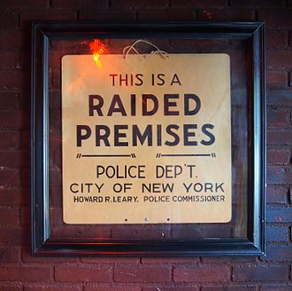 Stonewall Inn - The sign left by police following the raid is now on display just inside the entrance
