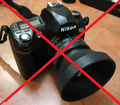 Striked Nikon camera on a table.png