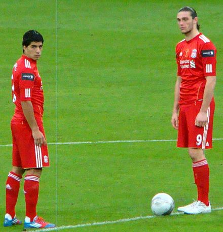 Suarez (left) was signed by Liverpool on the same day as Andy Carroll Suarez and Carroll crop.jpg