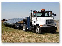 international 8100 4x2 tractor towing solar panels