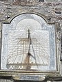 Sundial above entrance to Church of St Peter, Tawstock, Devon, showing time in cities across the world.jpg