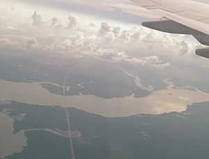 Johor River - Westward looking aerial view of the Johor River estuary at Sungai Johor Bridge. The water body on the right is Lower Layang Reservoir. The tributary on the left is Lebam River (Sungai Lebam)