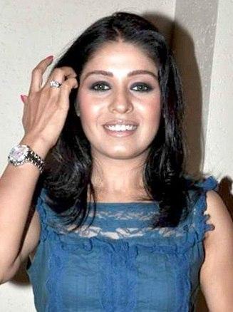 Sunidhi Chauhan smiling looking at camera
