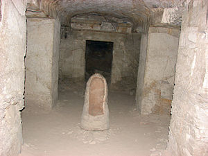 TT55 - View of burial chamber, showing trace paint on opposing lintel, and urn.