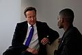 Tanzanian campaigner Frank shares his experience of hunger with Prime Minister David Cameron (8984091217).jpg