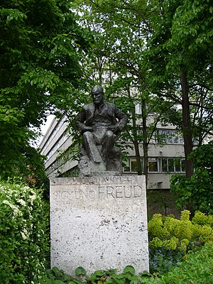 Sigmund Freud memorial in Hampstead, North London. Sigmund and Anna Freud lived at 20 Maresfield Gardens, near to this statue. Their house is now a museum dedicated to Freud's life and work. [1] The building behind the statue is the Tavistock Clinic, a major psychiatric institution.