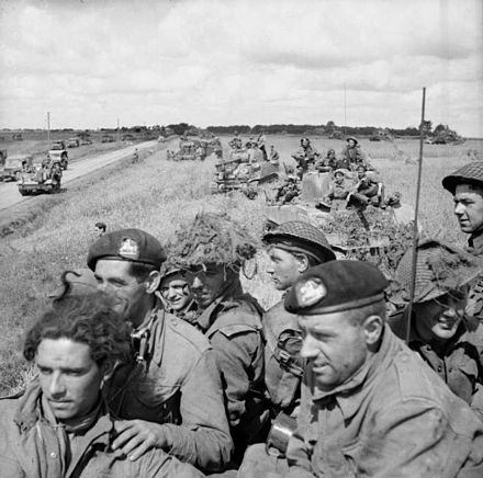 British infantry aboard Sherman tanks wait for the order to advance, near Argentan, 21 August 1944.