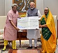 The Head of All World Gayatri Pariwar, Dr. Pranav Pandya presenting a demand draft of Rs.1.25 crore to the Prime Minister, Shri Narendra Modi, towards the Prime Minister's National Relief Fund, in New Delhi.JPG