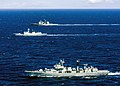 The People's Liberation Army-Navy destroyer Qingdao (DDG 113), foreground, frigate Linyi (FFG 547), and the U.S. Navy guided-missile cruiser USS Lake Erie (CG 70) operate together off Oahu, Hawaii, during a search and rescue exercise.JPG