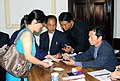 The Polling officer administering indelible ink at the finger of a female voter at a polling booth, Gangtok in Sikkim, during the third phase of General Election-2009 on April, 30, 2009.jpg