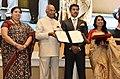 The President, Shri Ram Nath Kovind presenting the Swarna Kamal Award to the director Rima Das, for best Assamese feature film – VILLAGE ROCKSTARS, at the 65th National Film Awards Function, in New Delhi.JPG