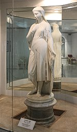 Full height, white marble statue of Veiled Rebecca at Salar Jung Museum