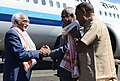 The Vice President, Shri M. Hamid Ansari being received by the Governor of Assam, Shri Banwarilal Purohit, on his arrival, at Tezpur Airport, in Assam.jpg