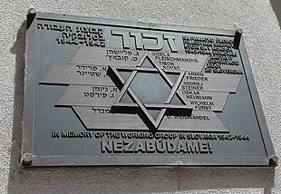 Metal plaque, in Slovak and Hebrew, on an exterior wall