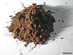 English: Cocoa, Cocoa powder, on a sheet of pa...