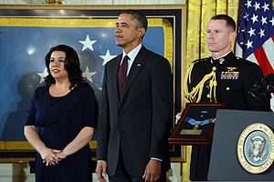 Tina Duran-Ruvalcaba, left, accepts the Medal of Honor on behalf of her late father, U.S. Army Spc. Jesus S. Duran, from President Barack Obama during a ceremony at the White House in Washington, D.C., March 18 140318-D-DB155-011.jpg