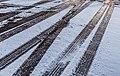 Tire tracks in the snow, winter road in Mankato, Minnesota (39981048084).jpg