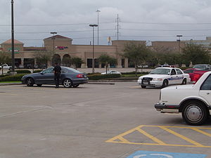 Traffic stop - Stafford Police Department making a traffic stop in the parking lot of The Fountains on the Lake shopping center in Fort Bend County, Texas. The driver of the gray Mercedes allegedly didn't stop for a stop sign.