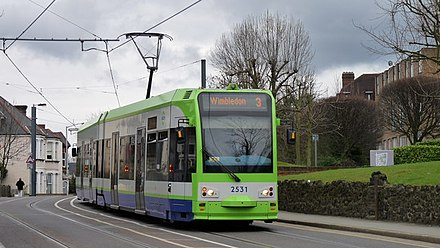 A route 3 tram leaving Lebanon Road, going west towards East Croydon
