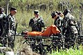 Transporting a Guantanamo captive on a stretcher in 2002-02.jpg
