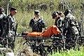 Transporting a Guantanamo captive on a stretcher in 2002-02.jpg