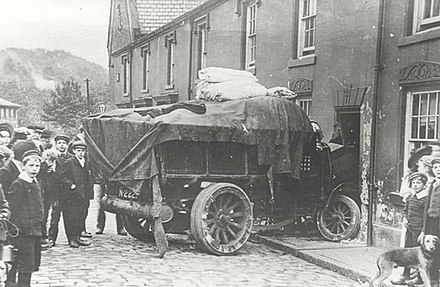 Truck collision with house in Compstall, United Kingdom (1914) Truck crash on Andrew Street, Compstall 1914.jpg