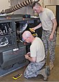 U.S. Air Force Airman 1st Class David Morse and Staff Sgt. Daniel Kristiansen, both with the 361st Training Squadron, check a meter to troubleshoot an electrical problem June 8, 2011, at Sheppard Air Force Base 110608-F-NS900-011.jpg