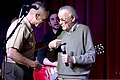 U.S. Marine Corps Brig. Gen. Vincent A. Coglianese, left, welcomes Stan Lee, right, to base during his opening remarks to Stan Lee's POW!er Concert at the Pacific Views Event Center, Camp Pendleton, Calif 130405-M-LD192-037.jpg