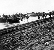 U.S. Marines storm ashore on Guadalcanal, 7 August 1942 (80-CF-112-5-3)