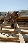 U.S. Navy Builder Constructionman Sparkle Campbell, assigned to Naval Mobile Construction Battalion (NMCB) 28, works on a demolition project at Kandahar Airfield, Kandahar province, Afghanistan, Oct. 2, 2013 131002-N-LT766-014.jpg