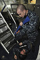 U.S. Navy Master-at-Arms 1st Class Charles Daniels, standing, role-plays as a hostage taker while Air Traffic Controller 2nd Class Morris Carey portrays a casualty during a training evolution aboard the aircraft 130130-N-JC752-055.jpg