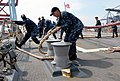 U.S. Sailors aboard the guided missile destroyer USS Momsen (DDG 92) secure mooring lines during Cooperation Afloat Readiness and Training (CARAT) 2013 in Jakarta, Indonesia, May 26, 2013 130526-N-YU572-133.jpg
