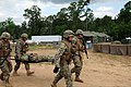 U.S. Sailors assigned to Naval Mobile Construction Battalion 11 participate in a mass casualty drill during a field exercise (FEX) at Camp Shelby, Miss., May 17, 2013 130517-N-UH337-014.jpg
