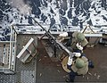 U.S. Sailors assigned to the amphibious transport dock ship USS Denver (LPD 9) fire a .50-caliber machine gun during a live-fire exercise March 10, 2014, in the East China Sea 140310-N-ZU025-293.jpg