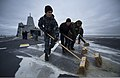 U.S. Sailors with the air department aboard the amphibious transport dock ship Pre-Commissioning Unit (PCU) Anchorage (LPD 23) scrub the flight deck as the ship navigates the Pacific Ocean toward Cook Inlet 130430-N-DR144-492.jpg
