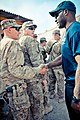 U.S. Soldiers with the 38th Engineer Company, 4th Brigade Combat Team, 2nd Infantry Division greet Cleveland Browns linebacker D'Qwell Jackson, right, during his visit to Kandahar province, Afghanistan, March 130318-A-DE841-738.jpg