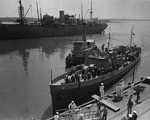 Bath Iron Works - USCGC Icarus (WPC-110) delivers prisoners from ''U-352'' to Charleston Navy Yard on 10 May 1942.