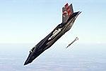 "USNA CDR Tony ""Brick"" Wilson piloting CF-05 during an external GBU-12 weapon separation.jpg"