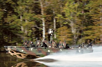 Go-fast boat - US Navy SEALs train with a modified go-fast boat during a training exercise in Mississippi