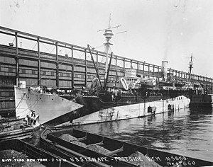 USS Lenape (ID-2700) on 20 August 1918. Note the coal barges and Lenape 's open coaling doors.