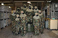 US Air Force (USAF) Airmen assigned to the 148th Fighter Wing (FW), Minnesota (MN) Air National Guard (ANG), pose for a group photograph wearing Mission-Oriented Protective Posture response level four (MOPP-4) 030223-F-YN338-001.jpg