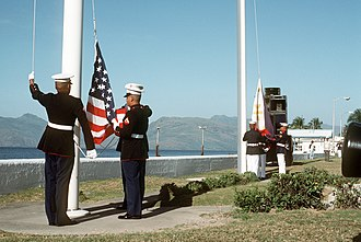 Presidency of Corazon Aquino - The American Flag is lowered and Philippine flag is raised during turnover of Naval Station Subic Bay.