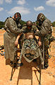 US Navy 030428-M-1852W-023 Hospital Apprentice Michael Jacoby and Hospitalman Derek Roe, assigned to the U.S. Marines 3rd Division Medical Battalion, work to decontaminate patient.jpg