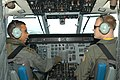 US Navy 030625-N-0493B-004 Royal Brunei Air Force (RBAF) pilot, Capt. Mohammad Sharif talks to his co-pilot, U.S Navy pilot Lt. j.g. Andrew Neboshynsky.jpg