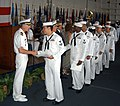 US Navy 030808-N-0275F-502 Sailors receive their Naturalization Certificates and their Presidential Letters after taking the oath to become United States Citizens.jpg